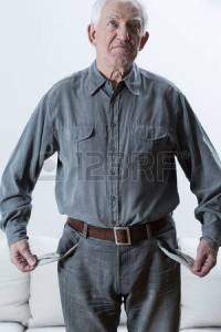 40570798-sad-elderly-poor-man-standing-with-empty-pockets