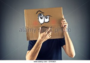 man-thinking-with-cardboard-box-on-his-head-with-serious-face-expression-dyknd1